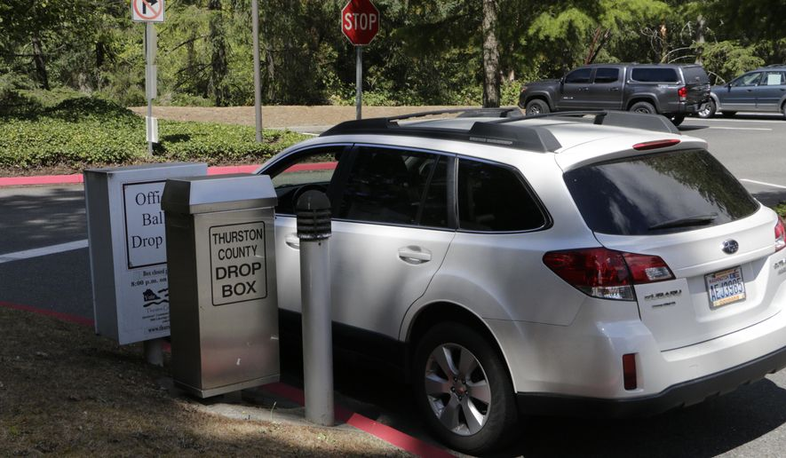 A car stops in front of a ballot drop off box at the Thurston County Courthouse in Olympia, Wash., on Tuesday, Aug. 2, 2016.  Washington's voters are weighing in on dozens of races across the state  as they winnow their choices for offices ranging from Congress to the Legislature in the state's primary election. (AP Photo/Rachel La Corte)