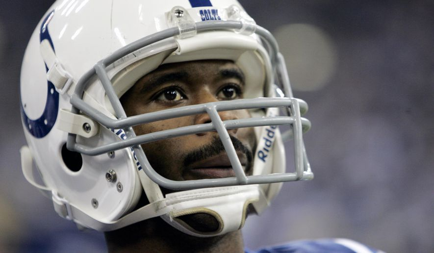 FILE - In this Dec. 18, 2016, file photo, Indianapolis Colts wide receiver Marvin Harrison looks on during a NFL football game against the San Diego Chargers in Indianapolis. Throughout his career, he avoided reporters, and even declined pre-induction to the hall interview requests. Some believe that after Colts owner Jim Irsay introduces Harrison, the acceptance speech could be one of the shortest in Hall of Fame history.  (AP Photo/Darron Cummings, File)