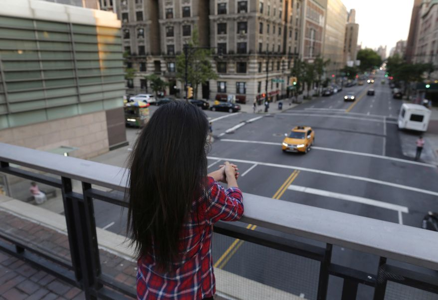 In this July 12, 2016, photo, Sameena, 22, a member of the Indian Dawoodi Bohra community, overlooks Amsterdam Ave. from a bridge during an interview with the Associated Press, in New York. While living her dream of being a graduate student at an Ivy League school in America, Sameena is also gradually coming to terms with the knowledge that she was circumcised at seven. At least 200 million girls and women alive today have undergone some form of female genital cutting, according to the United Nations, 70 million more than in 2014 because of increases in both population and reporting. (AP Photo/Julie Jacobson)