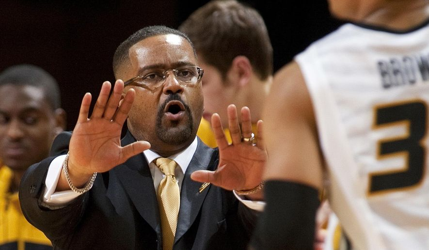 FILE - In this Feb. 19, 2014, file photo, Missouri head coach Frank Haith, left, slows down player Jabari Brown, right, who brings the ball upcourt during the second half of an NCAA college basketball game against Vanderbilt in Columbia, Mo. Haith, the former coach at Miami, was suspended for five games by the NCAA at the start of the 2013-14 season for inadequately monitoring former assistants interactions with a disgraced Miami booster and then trying to cover up a five-figure hush money payment to keep potential violations hidden. (AP Photo/L.G. Patterson, File)