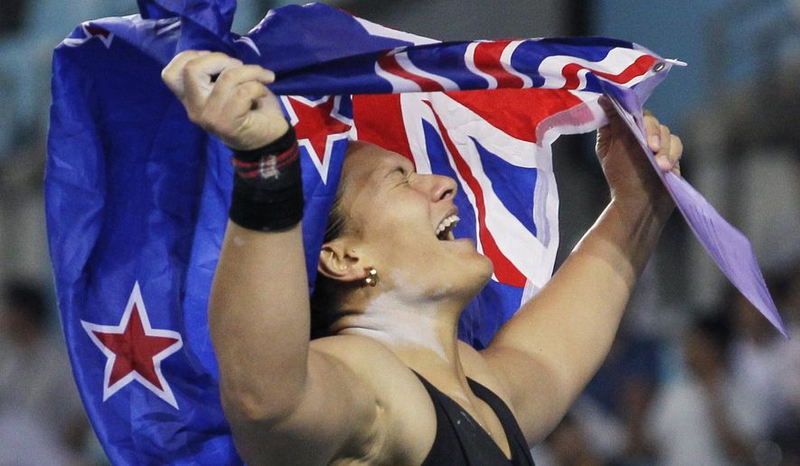 FILE - In this Aug. 29, 2011, file photo, New Zealand's Valerie Adams celebrates winning gold in the Women's Shot Put final at the World Athletics Championships in Daegu, South Korea. Adams will attempt at the Rio de Janeiro Games to become the first woman to win the same individual track and field event at three consecutive Olympics. (AP Photo/Anja Niedringhaus, File)