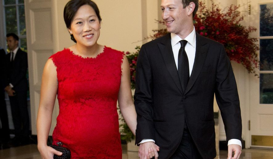 FILE - In this Friday, Sept. 25, 2015, file photo, Facebook Chairman and CEO Mark Zuckerberg and his wife, Priscilla Chan, arrive for a State Dinner in honor of Chinese President Xi Jinping, in the East Room of the White House in Washington. Despite no national law, paid family leave benefits are rising in some business sectors and regions thanks to company policy and laws. A majority of Americans over 40 support paid leave to care for family. Highly visible executives, like Zuckerberg, have spoken out in favor of paid family leave laws. He announced with a status update on Facebook that he was taking two months of parental leave to help care for his new daughter. Facebook offers 16 weeks of paid leave to new mothers and fathers. (AP Photo/Manuel Balce Ceneta, File)