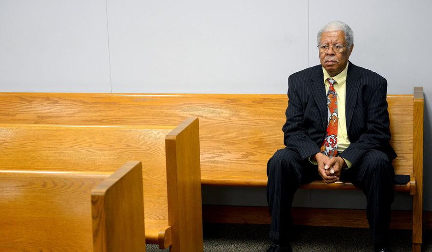 Former Ingham County Prosecutor Stuart Dunnings III waits for his preliminary hearing Tuesday, Aug. 2, 2016, in Judge Michael Klaeren's courtroom at the Jackson County Courthouse in Jackson, Mich. Tuesday, Aug. 2, 2016, in the Jackson County Courthouse in Jackson, Mich. Stuart Dunnings III  who served as prosecutor in Michigan's capital for nearly 20 years pleaded guilty Tuesday to misconduct in office in a prostitution investigation that grew out of a human-trafficking probe and forced him to quit. (Dave Wasinger/Lansing State Journal via AP)