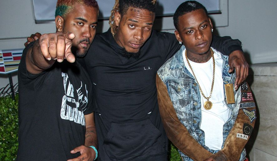 FILE - In this July 14, 2015 file photo, The Remy Boyz, from left, P-Dice, Fetty Wap, and Monty attend the BODY at ESPYs party in Los Angeles. P-Dice, born Justin Pope, was freed from jail after posting $250,000 bail. He faces charges of attempted murder and weapons offenses stemming from the February shooting that injured a 7-year-old boy in Paterson, N.J. (Photo by Paul A. Hebert/Invision/AP, File)