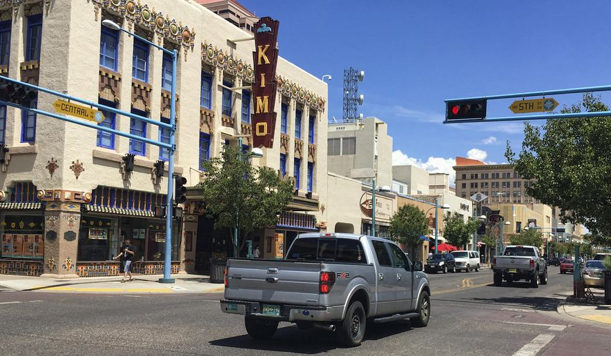 This Monday, Aug. 1, 2016 photo shows the Kimo Theater on Albuquerque's historic Route 66. The fight over Albuquerque's plans for building a rapid transit route along a stretch of historic Route 66 is drawing fierce protest from some residents and business owners along the famed highway and is one of many fights between residents and planners amid pushes to revamp Route 66 in eight states. (AP Photo/Russell Contreras)