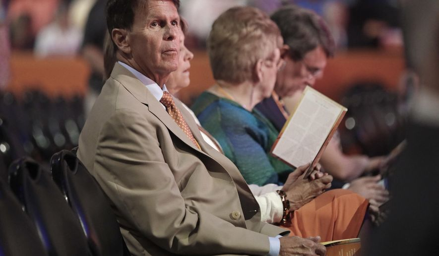 In this July 14, 2016 photo, Tennessee athletic director Dave Hart, left, waits for the start of the ceremony to celebrate the life of former Tennessee women's basketball coach Pat Summitt in Knoxville, Tenn. Hart acknowledges this has been an emotional year as the school has settled a Title IX lawsuit, mourned the death of former women's basketball coach Pat Summitt and has prepared for the pending departure of chancellor Jimmy Cheek. (AP Photo/Mark Humphrey, Pool)