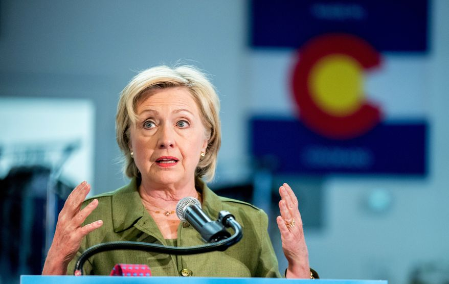 Democratic presidential candidate Hillary Clinton speaks after a tour of the Knotty Tie Company in Denver, Wednesday, Aug. 3, 2016. The Knotty Tie Company makes and manufactures ties and scarves by hand in Denver. (AP Photo/Andrew Harnik)