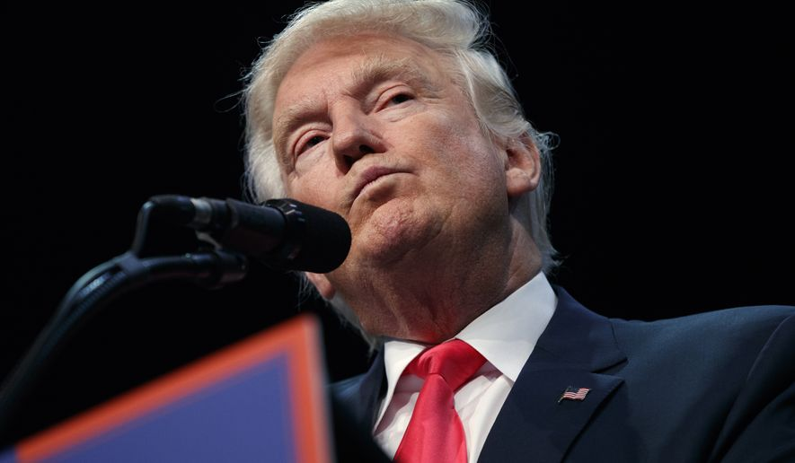 Republican presidential candidate Donald Trump pauses while speaking at a campaign town hall at Ocean Center, Wednesday, Aug. 3, 2016, in Daytona Beach, Fla. (AP Photo/Evan Vucci)