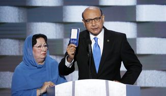Khizr Khan, father of fallen US Army Capt. Humayun S. M. Khan speaks as his wife Ghazala listens during the final day of the Democratic National Convention in Philadelphia , Thursday, July 28, 2016. (AP Photo/J. Scott Applewhite)