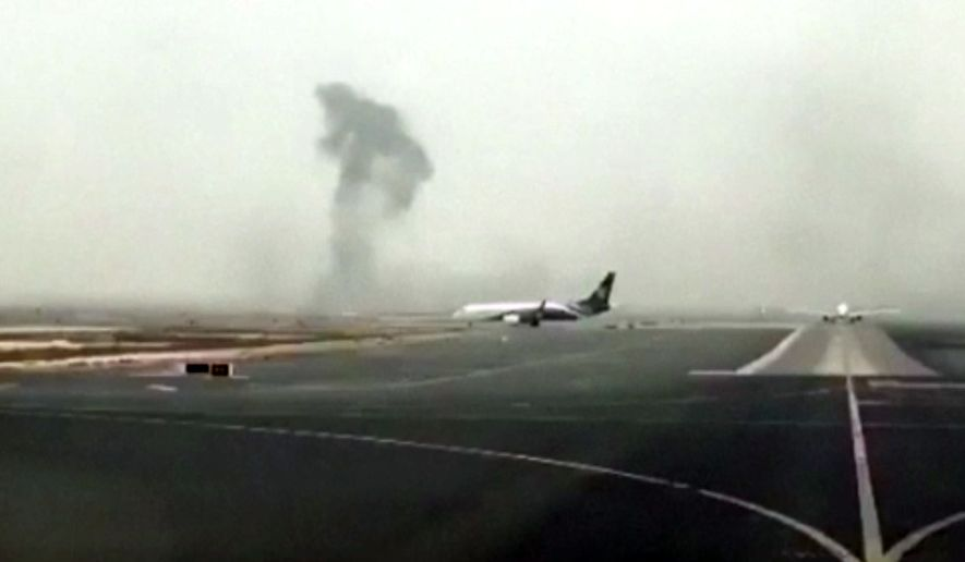 This image made from video shows smoke rising after an Emirates flight crash landed at Dubai International Airport on Wednesday, Aug. 3, 2016. The plane at right was unaffected Dubai-based airline Emirates has confirmed that there were no fatalities on a flight from India that crash-landed . The carrier says all passengers and crew are accounted for and safe. It raised the number of people onboard the flight to 300, saying there were 282 passengers, 18 crew.(Hayen Ayari via AP)