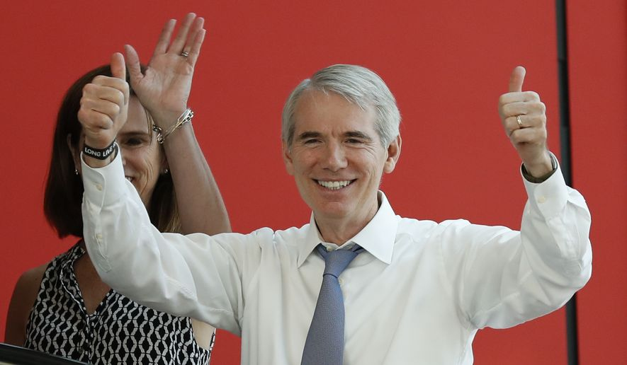 In this July 19, 2016, file photo, Sen. Rob Portman, R-Ohio, right, arrives with his wife arrive at the The Rock and Roll Hall of Fame and Museum in Cleveland, during the second day of the Republican convention. (AP Photo/Alex Brandon, File)