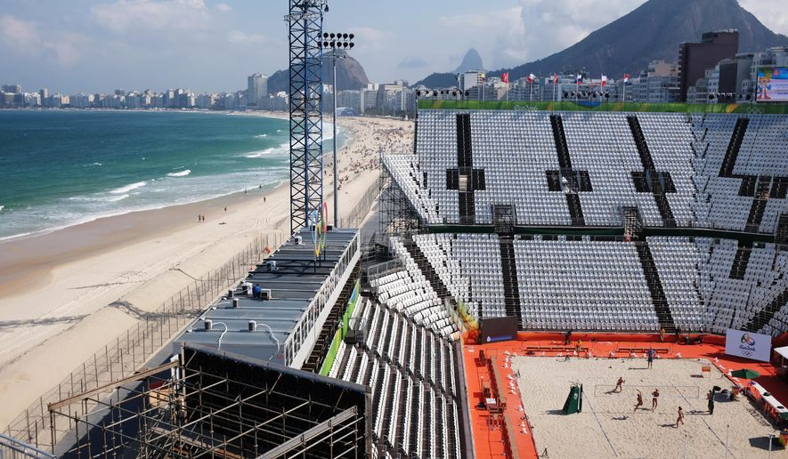 Beach volleyball players practice on center court of the beach volleyball arena along Copacabana Beach ahead of the upcoming 2016 Summer Olympics in Rio de Janeiro, Brazil, Tuesday, Aug. 2, 2016. (AP Photo/David Goldman)