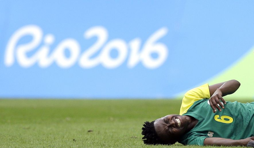 South Africa's Mamello Makhabane grimaces in pain after being fouled during the opening match of the women's Olympic football tournament between Sweden and South Africa at the Rio Olympic Stadium in Rio de Janeiro, Brazil, Wednesday, Aug. 3, 2016. (AP Photo/Leo Correa)