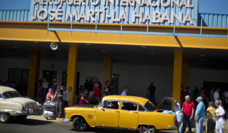 In this Sept. 1, 2014 photo, people put their luggage in a private taxi as they arrive from the U.S. to the Jose Marti International Airport in Havana, Cuba.  The rise in Cuba's tourism has strained the country's infrastructure, filling hotels to capacity and creating long waits at airport. The government announced Wednesday, Aug. 3, 2016, that Aeroports de Paris, the French government-controlled firm that runs Charles de Gaulle, Orly and other Paris airports, would receive a concession to operate Jose Marti, which would be renovated by the French firm Bouygues. (AP Photo/Ramon Espinosa, File)