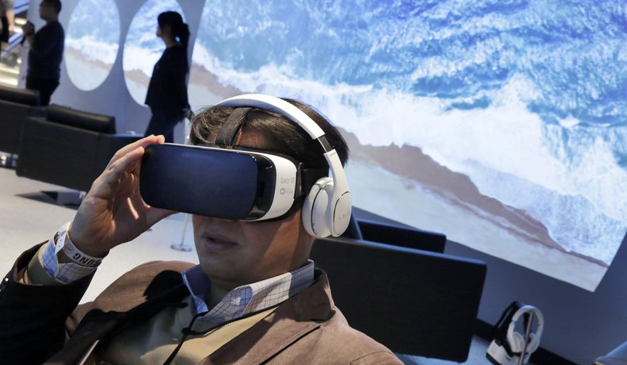 FILE - In this Monday, Feb 22, 2016, file photo, a Samsung Gear VR oculus is demonstrated during a preview of Samsung's flagship store, Samsung 837, in New York's Meatpacking District. NBC is making 4,500 hours of Olympics coverage available at NBCOlympics.com and the NBC Sports app, starting with preliminary soccer events on Wednesday, Aug. 3.  (AP Photo/Richard Drew, File)