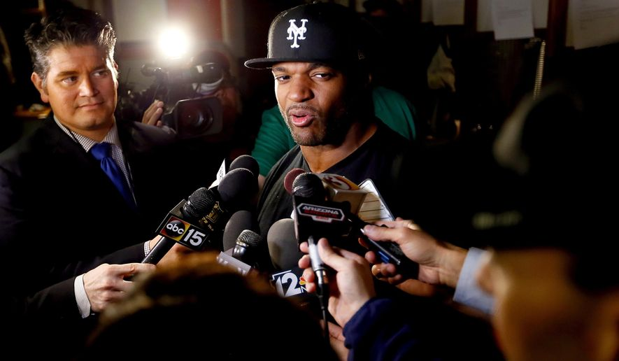 FILE - In this Jan. 25, 2016, file photo, then-Arizona Cardinals inside linebacker Dwight Freeney talks to reporters in the teams locker room, in Tempe, Ariz. The Atlanta Falcons' newly signed pass-rush star Dwight Freeney is expected to make his practice debut on Thursday, Aug. 4, 2016, in Flowery Branch, Ga.  (AP Photo/Matt York, File)