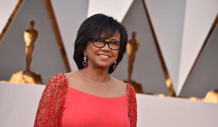 FILE - In this Feb. 28, 2016 file photo, President of the Academy of Motion Picture Arts and Sciences Cheryl Boone Isaacs arrives at the Oscars at the Dolby Theatre in Los Angeles. The film academy announced Tuesday, Aug. 2, 2016, that Boone Isaacs had been re-elected by its leadership to serve another one-year term as its president. (Photo by Jordan Strauss/Invision/AP, File)