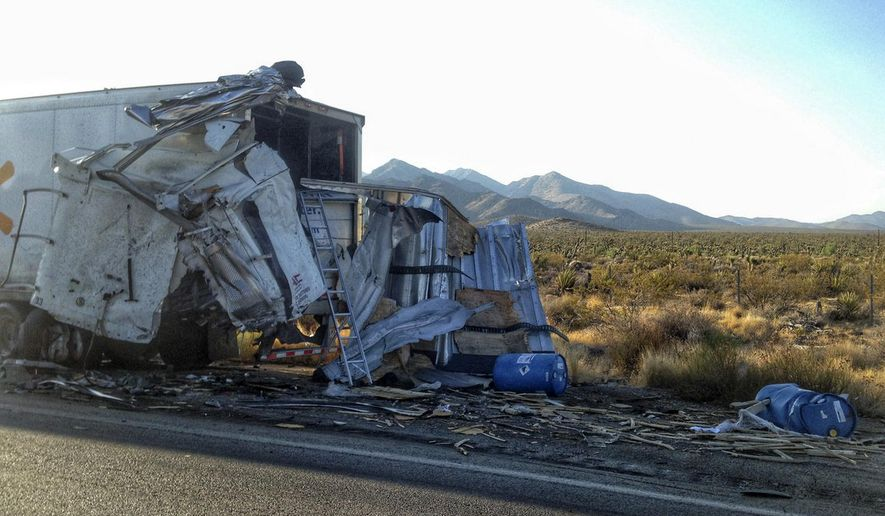 This photo provided by San Bernardino County Fire District shows the remains of a semi-truck that crashed   on a remote stretch of Interstate 15 in the Southern California desert near the Nevada border on Wednesday, Aug. 3, 2016. The California Highway Patrol says the interstate was closed for hours in both directions following the crash. ( John Miller/San Bernardino County Fire District via AP)