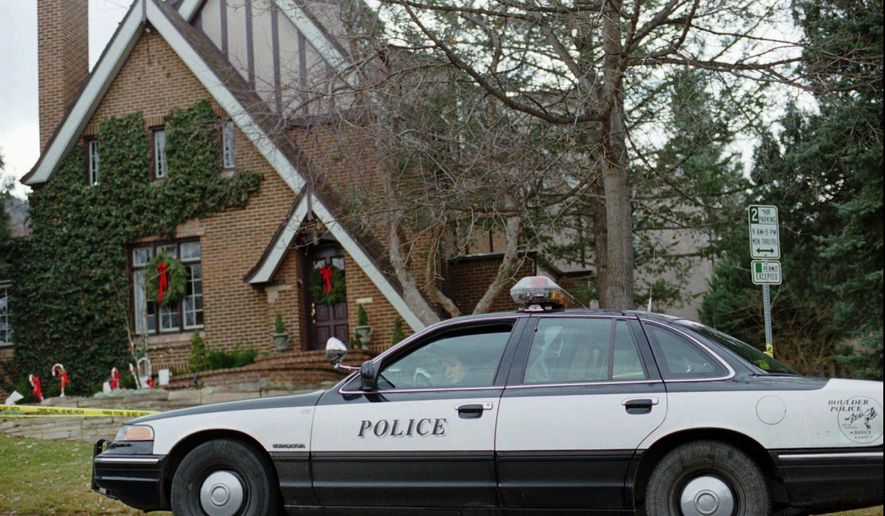 "In this Jan. 3, 1997, file photo, a police officer sits in her cruiser outside the home in which 6-year-old JonBenet Ramsey was found murdered in Boulder, Colorado, on Dec. 26, 1996. The ""Dr. Phil"" show announced August 1, 2016, that the girl's older brother, Burke, will discuss the case for the first time publicly in an interview to be broadcast in September. (AP Photo/David Zalubowski, File)"