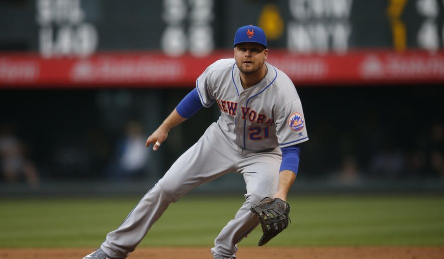 FILE - In this Friday, May 13, 2016 photo, New York Mets first baseman Lucas Duda (21) prepares to field a ball in the first inning of a baseball game against the Colorado Rockies in Denver. Mets first baseman Lucas Duda will likely not play again this season because of a recurrence of back pain. General manager Sandy Alderson said Wednesday, Aug. 3, 2016, that Duda's back flared up late last week during baseball drills at the team's spring training complex in Port St. Lucie, Fla.(AP Photo/David Zalubowski, File)