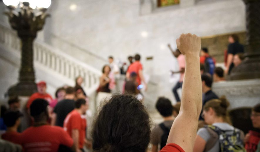 Members of 15 Now, NOC, CTUL and other groups rally at the Minneapolis City Council Chambers, Wednesday, Aug. 3, 2016, trying to get a $15 minimum wage on the Minneapolis ballot in November.(Glen Stubbe/Star Tribune via AP)