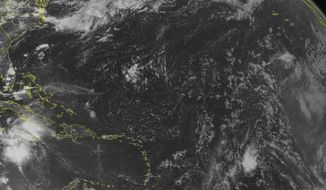This NOAA satellite image taken Tuesday, Aug. 2, 2016 at 12:45 PM EDT shows Tropical Storm Earl 210 miles south of Grand Cayman with maximum winds of 50 miles per hour. Earl is moving west at 22 miles per hour towards the Yucatan Peninsula. To the east, high pressure brings mostly sunny skies to the eastern Caribbean Sea. (Weather Underground via AP)