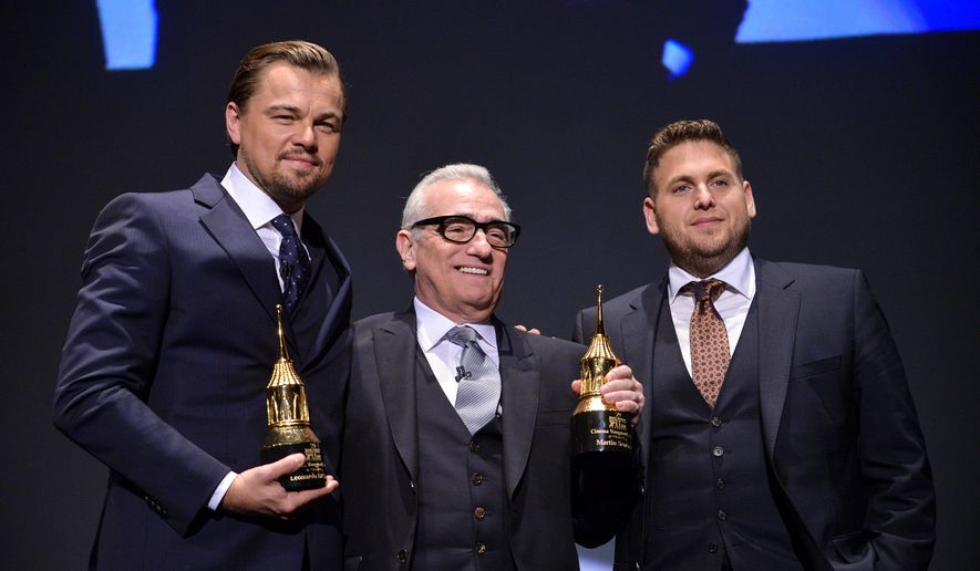 FILE - In this Feb, 6, 2014, file photo, Leonardo DiCaprio, Martin Scorsese, and Jonah Hill are seen onstage at 2014 Santa Barbara International Film Festival - Cinema Vanguard Award ceremony in Santa Barbara, Calif. A video posted online by E! on August 2, 2016, shows DiCaprio pranking Hill on a New York City street. (Photo by Richard Shotwell/Invision/AP, File)