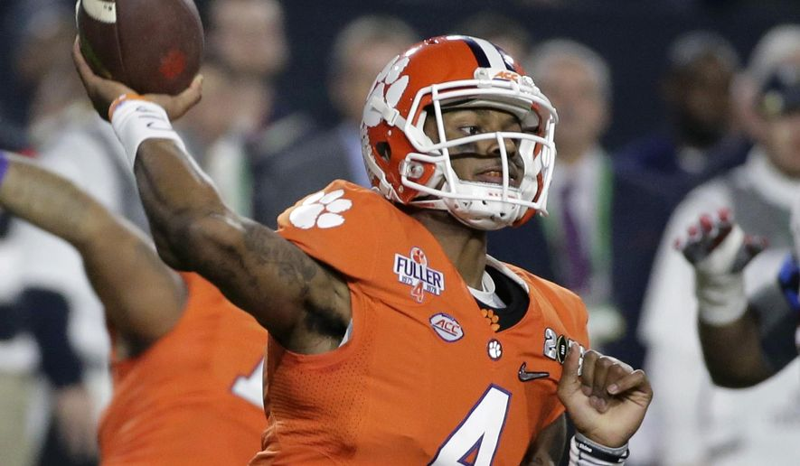 FILE - In this Jan. 11, 2016, file photo, Clemson quarterback Deshaun Watson throws during the first half of the NCAA college football playoff championship game against Alabama, in Glendale, Ariz. Watson is the favorite to win the Heisman Trophy and the leader of a team with hopes of getting back to the College Football Playoff. (AP Photo/Chris Carlson, File)