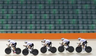 Members of the German men's track cycling team round the track during a training session inside the Rio Olympic Velodrome in advance of the 2016 Olympic Games in Rio de Janeiro, Brazil, Tuesday, Aug. 2, 2016. (AP Photo/Patrick Semansky)