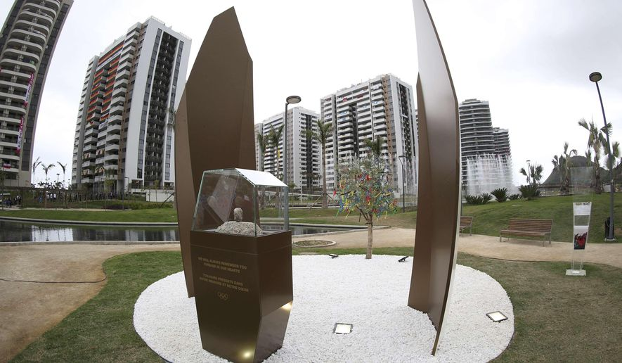 A memorial in honor of Israeli Olympic athletes killed by Palestinian gunmen at the 1972 Munich Olympics stands in the Olympic Village ahead of the Summer Olympics in Rio de Janeiro, Brazil, Wednesday, Aug. 3, 2016. The International Olympic Committee (IOC) inaugurated the memorial on Wednesday in honor of the 11 Israelis who were killed. (AP Photo/Edgard Garrido, Pool)