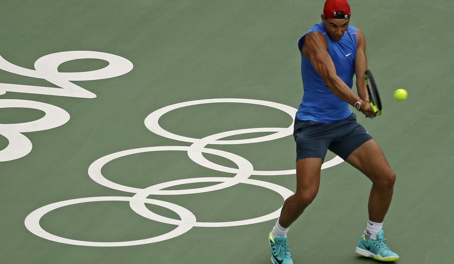 Spain's Rafael Nadal practices during a training session at the Olympic Tennis Center at the Olympic park in Rio de Janeiro, Brazil, Wednesday, Aug. 3, 2016. The Summer 2016 Olympics is scheduled to open Aug. 5. (AP Photo/Charlie Riedel)