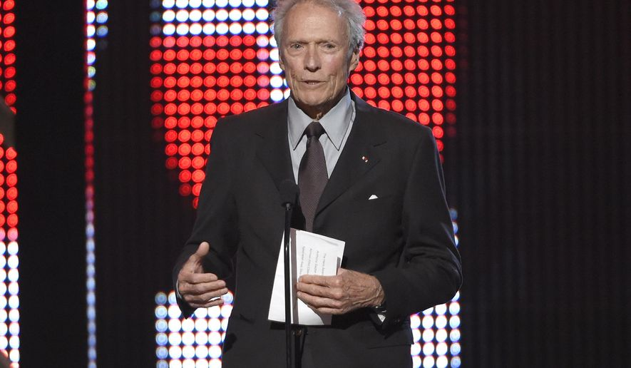 """FILE - In this June 4, 2016 file photo, Clint Eastwood presents the hero award at the Guys Choice Awards at Sony Pictures Studios in Culver City, Calif. Eastwood has stopped short of endorsing Donald Trump, but in an interview in Esquire magazine he praised the Republican presidential candidate for being """"on to something."""" In the interview posted online Wednesday, Aug. 3, 2016, the actor-director hailed Trump as a foe of political correctness and lamented what he called """"the kiss-ass generation."""" (Photo by Chris Pizzello/Invision/AP, File)"""