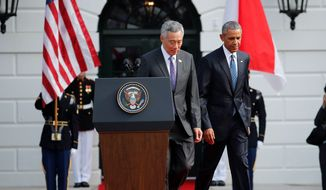 President Obama and visiting Singaporean Prime Minister Lee Hsien Loong warned Tuesday about the implications of a failed Trans-Pacific Partnership, including a trade deal with low standards. (Associated Press)