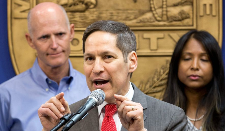 Centers for Disease Control and Prevention Director Dr. Tom Frieden (center) with Florida Gov. Rick Scott (left) and Florida Surgeon General and Secretary Dr. Celeste Philip, said no one should be surprised if more infections are detected despite and urged pregnant women to stay away from the area. (Associated Press)