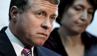 Rep. Charlie Dent, Pennsylvania Republican, accompanied by Rep. Cathy McMorris Rodgers, Washington Republican, speak to reporters on Capitol Hill in Washington on Oct. 4, 2011. (Associated Press) **FILE**