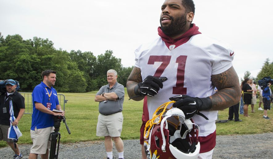 Washington Redskins offensive tackle Trent Williams (71) jogs to the field during the NFL football team's minicamp at the Redskins Park in Ashburn, Va., Wednesday, June 15, 2016. (AP Photo/Manuel Balce Ceneta)