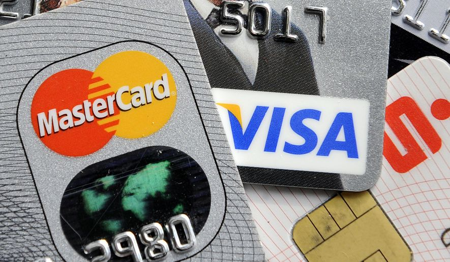 Credit and bank cards with electronic chips are shown in this November 2009 file photo. (AP Photo/Martin Meissner, File) **FILE**