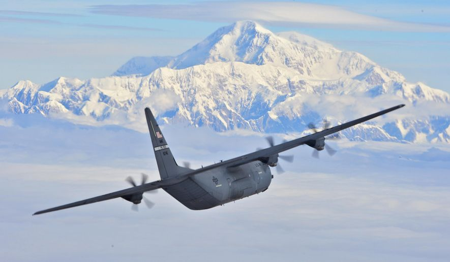 This July 19, 2016, photo provided by the U.S. Air Force shows a C-130J from the 41st Airlift Squadron flying past Denali, North America's tallest mountain located in Denali National Park, Alaska. The squadron provided combat airlift as part of its pre-deployment training ahead of Arctic Anvil, the largest military training exercise held in Alaska in 15 years. (Senior Airman Kaylee Clark/U.S. Air Force via AP)