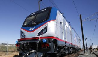 In this May 13, 2013, file photo one of the new Amtrak Cities Sprinter Locomotive makes a demonstration run during unveiling ceremonies at the Siemens Rails Systems factory in Sacramento, Calif. (AP Photo/Rich Pedroncelli, File)