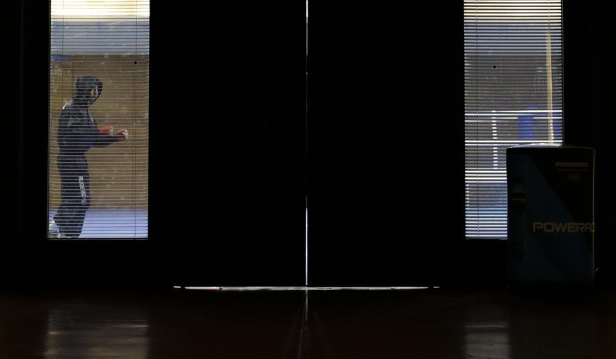 A boxer warms up in a training area in Riocentro ahead of the 2016 Summer Olympics in Rio de Janeiro, Brazil, Wednesday, Aug. 3, 2016. (AP Photo/Frank Franklin II)