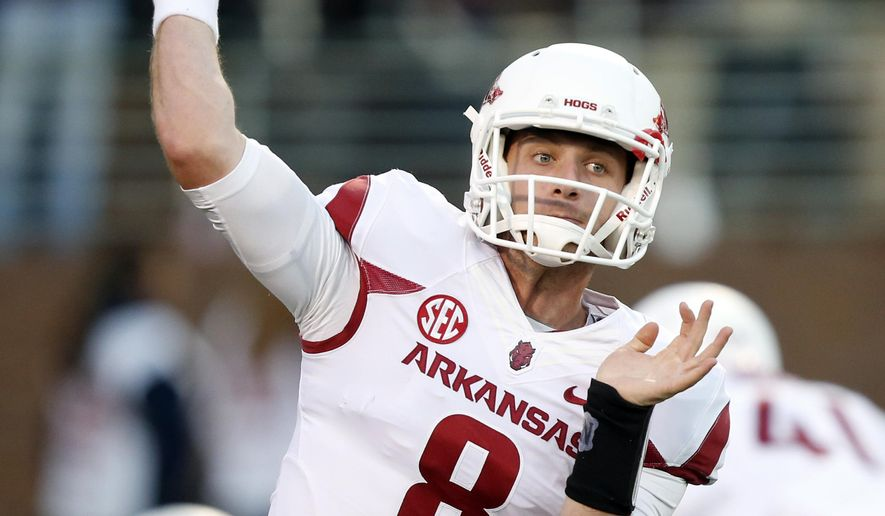FILE - In this Nov. 1, 2014, file photo, Arkansas quarterback Austin Allen (8) throws before an NCAA college football game against Mississippi State,  in Starkville, Miss. Austin Allen can't remember the last time he's taken a hit during a game. That figures to change quickly for Arkansas' new starting quarterback, who is taking over under center after three seasons of watching his older brother, Brandon, lead the Razorbacks. (AP Photo/Rogelio V. Solis, File)