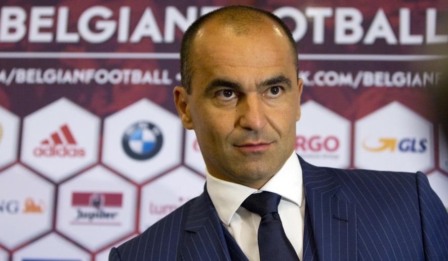 Spain's Roberto Martinez arrives for a media conference at the headquarters  of the Belgian Football Association  in Brussels on Thursday, Aug. 4, 2016. Martinez has been named the new head coach for the Belgian national soccer team.  (AP Photo/Virginia Mayo)