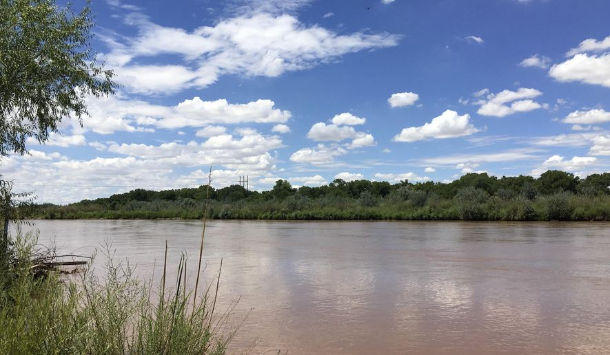 The Rio Grande, a main source of water for New Mexico residents and farmers, is shown in Albuquerque's North Valley on Thursday, Aug. 4, 2016. Despite the start of monsoon season, most of New Mexico is under moderate drought thanks to high temperatures last month and below average rainfall. (AP Photo/Russell Contreras)