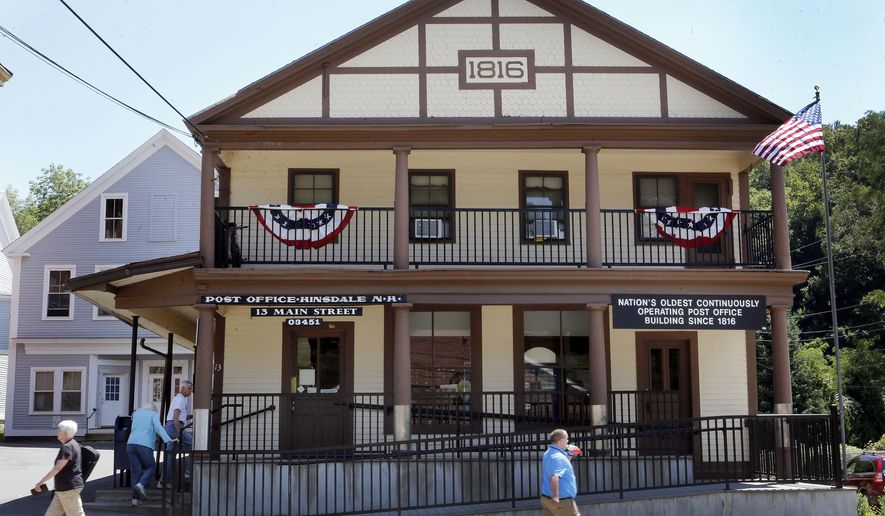 the oldest continuously operating post office in the U.S., the Hinsdale Post Office is seen Thursday Aug. 4, 2016 in Hinsdale, New Hampshire. The post office is celebrating it's 200th birthday. (AP Photo/Jim Cole)