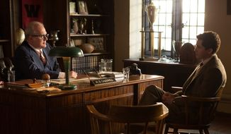 "In this image released by Roadside Attractions, Tracy Letts, left, and Logan Lerman appear in a scene from, ""Indignation."" The film is an adaptation of the 2008 Philip Roth novel. It's a 1950s-set tale about a stringently principled Jewish kid from Newark, who having fled his overbearing father finds both unexpected sexual freedom and institutional rigidity at college in Ohio. (Alison Cohen Rosa/Roadside Attractions via AP)"