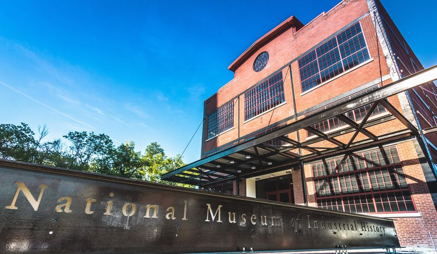 This July 25, 2016, handout photo provided by the National Museum of Industrial History shows the exterior of the museum, housed in a century-old building at the former Bethlehem Steel plant in Bethlehem, Pa. The National Museum of Industrial History opened Tuesday, Aug. 2, 2016, after nearly 20 years of planning, and the Smithsonian Institution-affiliated museum is located on what was once one of America's largest abandoned industrial sites where it joins the nearby Sands Casino Resort Bethlehem and a thriving arts complex called SteelStacks. (Glenn Koehler/National Museum of Industrial History via AP)