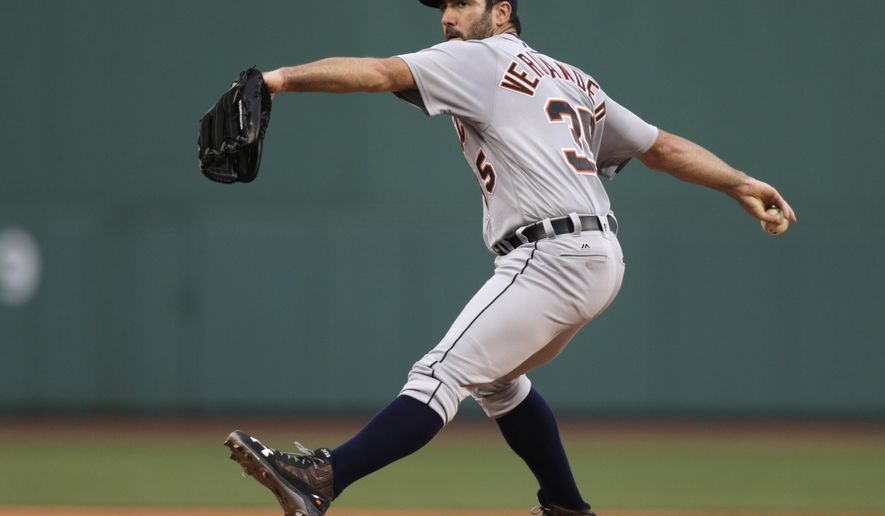 FILE - In this July 25, 2016, file photo, Detroit Tigers starting pitcher Justin Verlander winds up during the first inning of a baseball game against the Boston Red Sox in Boston. Verlander is scheduled to start for the Tigers in the opening game of a series Friday, Aug. 5, against the New York Mets.  (AP Photo/Charles Krupa, File