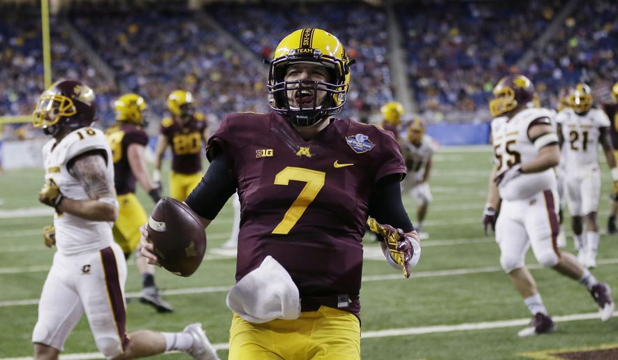 FILE - In this Dec. 28, 2015, file photo, Minnesota quarterback Mitch Leidner celebrates after outrunning the Central Michigan defense for the go-ahead touchdown during the second half of the Quick Lane Bowl NCAA college football game, in Detroit. Leidner has had his share of struggles as Minnesota's quarterback, but a strong finish to the 2015 season and a subsequent surgery to clean up an injury to his left foot has him set up for a stellar senior year for the Gophers. (AP Photo/Carlos Osorio, File)