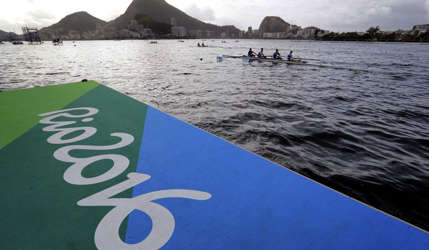 FILE - In this Aug. 3, 2016 file photo, athletes warm up during rowing team practices in Lagoa ahead of the 2016 Summer Olympics in Rio de Janeiro, Brazil. The 2016 Olympic Games come at a dire time for Brazil. The country is enduring myriad calamities: the deepest recession in memory, a political crisis, violent street protests and a public health emergency caused by the Zika virus. (AP Photo/Matt York)