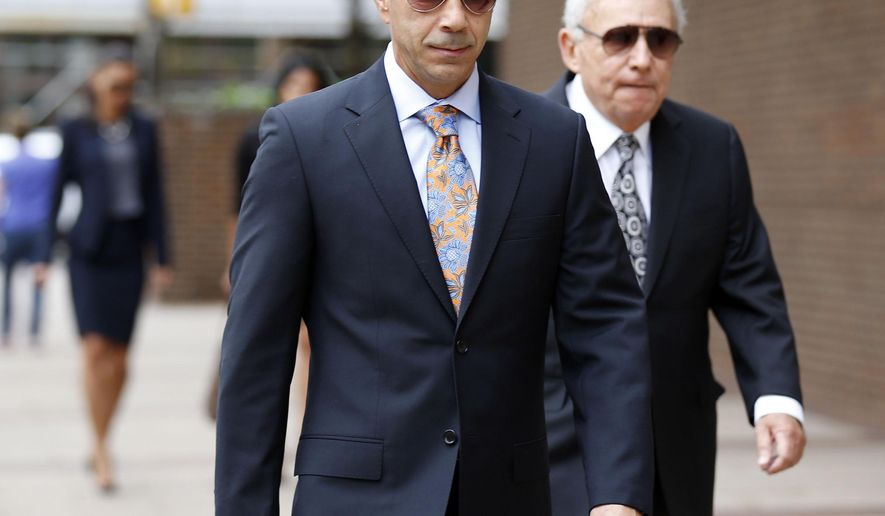 FILE - In this Oct. 10, 2014 file photo, Joey Merlino arrives at the federal court in Philadelphia. The flamboyant alleged head of the Philadelphia mob who has repeatedly beat murder charges in past cases is among nearly four dozen people Thursday, Aug. 4, 2016, with being part of an East Coast crime syndicate. (Yong Kim/Philadelphia Daily News via AP, File)